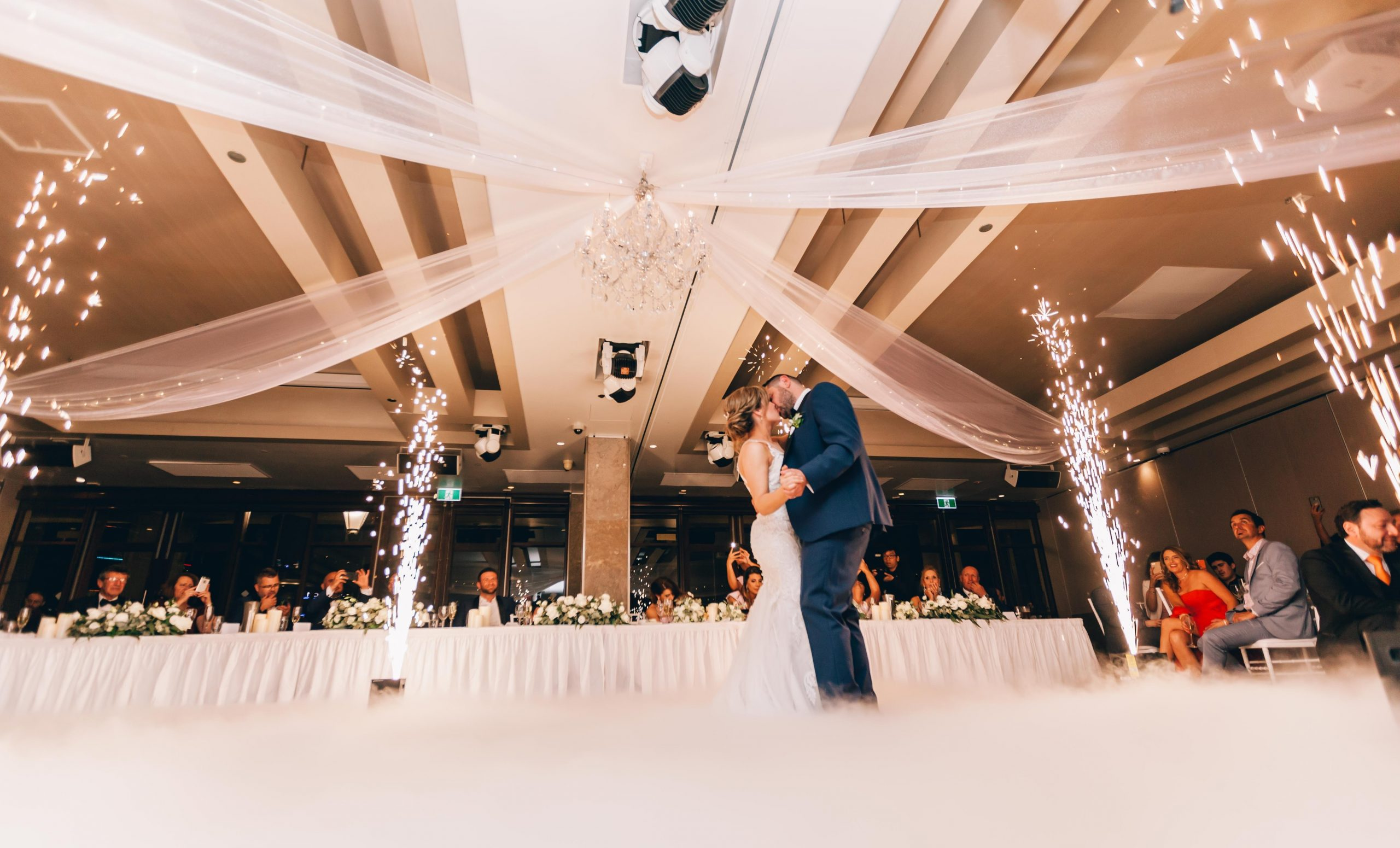 low-angle-photography-of-bride-and-groom-dancing-3082764